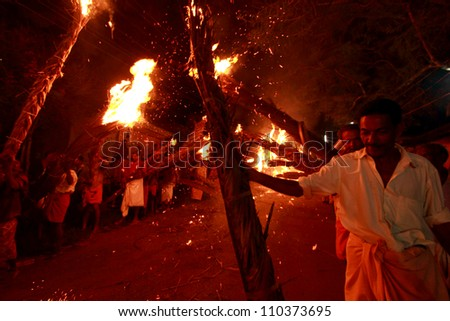 KADAMMANITTA, INDIA - APRIL 22: People holding fire parading at the annual Padayani festival on April 22, 2012 at Kadammanitta temple,Kerala, India. Padayani is a ritualistic dance drama of Kerala.