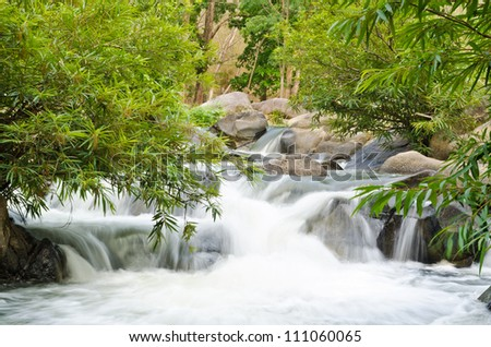 Kaengsommaw. Small waterfall in tropical forests of Thailand. - stock photo