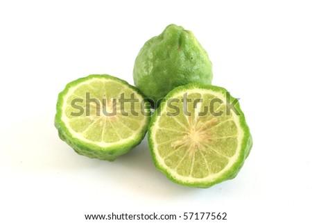Kaffir limes on white background - stock photo