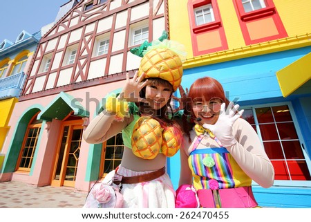 KAGAWA, JAPAN - MARCH 13: Dancers in colorful costumes participate in a parade, celebrating Reoma World Theme Park Renewal Open Anniversary on March 13, 2015 in Marugae, Kagawa, Japan - stock photo