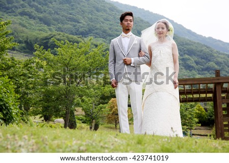 KAGAWA, JAPAN - MAY 15, 2016: Beautiful Japanese wedding couple wedding in Zentuji-Gogakunosato Park. Young wedding couple, beautiful bride with groom portrait. May 15, 2016 in Kagawa, Japan.
