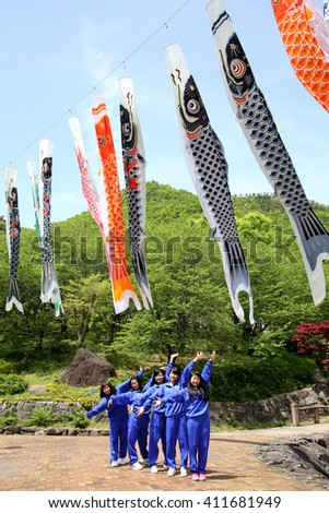 KAGAWA, JAPAN - MAY 22, 2016: Excursion of an Japanese high school girls, they are poseing pleasant and fun in a row at Fudonotaki- park, Kagawa, Japan.  - stock photo