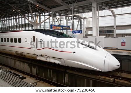 KAGOSHIMA CITY, JAPAN - MARCH 20:  Starting service to Fukuoka March 12,  2011 Kyushu Shinkansen 800 series bullet train at platform of Kagoshima Chuo Station, Kagoshima City, Japan, March 20, 2011. - stock photo