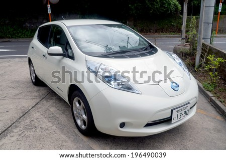 KAGOSHIMA - November 12:Nissan Leaf in Kagoshima on November 12, 2013. Nissan Leaf is the first mass-produced electric car. - stock photo