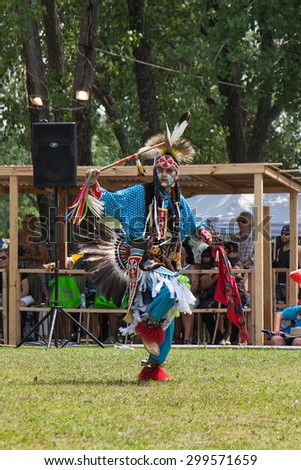 KAHNAWAKE, QUEBEC, CANADA - JULY 12, 2015 : Pow pow dancers take part in Kahnawake 25th Annual Echoes Of A Proud Nation Pow Wow in Kahnawake reserve, Quebec, Canada on July 12, 2015 - stock photo