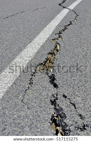 Kaikoura, New Zealand - November 15, 2016: Closeup of road cracks in the Hunderlee Hills on the road to Kaikoura following the 7.5  Kaikoura Earthquake this week.