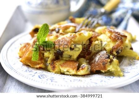 Kaiserschmarrn - traditional austrian pancake dessert with raisins. - stock photo
