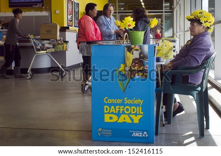 KAITAIA, NZ - AUG 29:Donation stand of Daffodil Day on Aug 29 2013.Since 1990 the NZ Cancer Society, Daffodil Day, provides an opportunity to raise awareness to cancer in New Zealand.