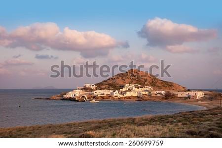 Kalafatis Bay beach on the island of Mykonos at sunset. Greece. - stock photo