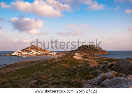 Kalafatis Bay beach on the island of Mykonos at sunset. Greece. - stock photo
