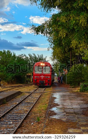 KALAMATA - GREECE SEPTEMBER 23 2015: The old historic train arrives in Kalamata station for the last time - stock photo