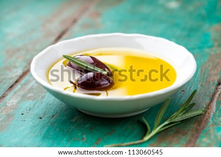 Kalamata olives in a bowl of olive oil - stock photo