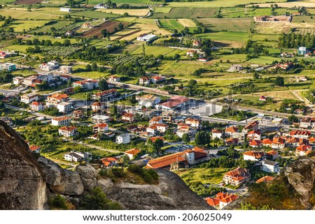 "Kalambaka city in Greece below the Meteora rocks, meaning ""suspended into air""  - stock photo"