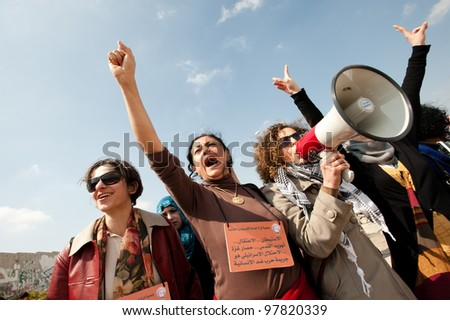 KALANDIA, OCCUPIED PALESTINIAN TERRITORIES - MARCH 8: Palestinian women, Israeli, and international solidarity activsits march to protest the Israeli occupation on International Women's Day 2012. - stock photo