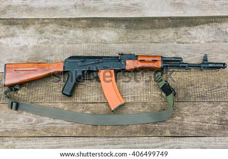 Kalashnikov assault rifle  ak-47, airsoft game, gun on the table, killer machine - stock photo