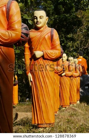 Kalattawa Buddhists temple with statues of monks in the four directions of the wind in Sri Lank - stock photo