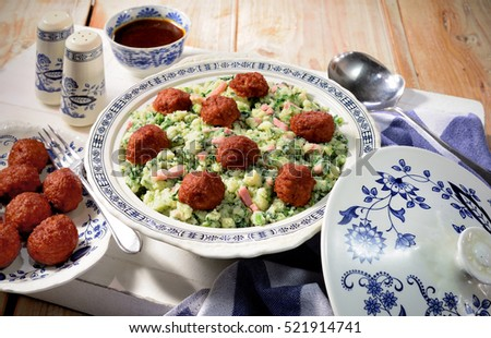 Kale, mashed potatoes and meatballs meal. Traditional Dutch winter 'stamppot' meal. Food for winter sports. Rustic kitchen background.