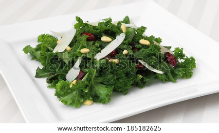 Kale salad served on a square plate. - stock photo
