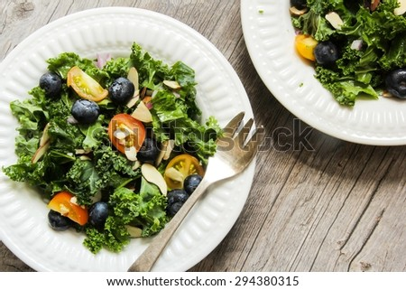 Kale salad with cherry tomatoes and blueberries