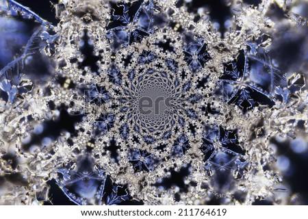 Kaleidoscopic Micro Photo of Snow Crystals - stock photo