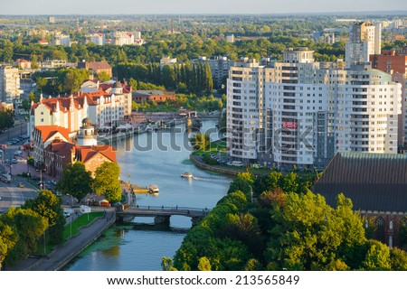 KALININGRAD, RUSSIA - AUGUST 26, 2014: Ethnographic and trade center, evening embankment of the Fishing Village. - stock photo