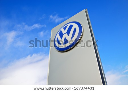 KALININGRAD, RUSSIA - JANUARY 2: The emblem dealership Volkswagen on January 2, 2014 in Kaliningrad, Russia. Volkswagen is a German multinational automotive manufacturing company - stock photo