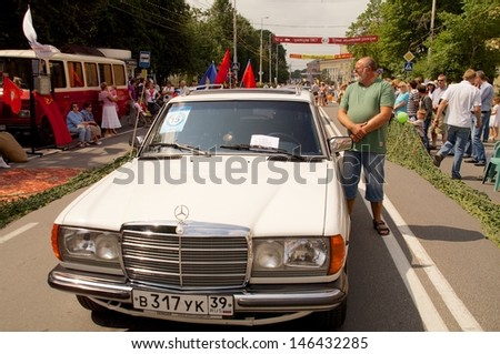 "KALININGRAD, RUSSIA - JULY 14: man and his old retro car ""Mersedes"" on the street on City Day of Kaliningrad celebration on July 14, 2013 in Kaliningrad, Russia"