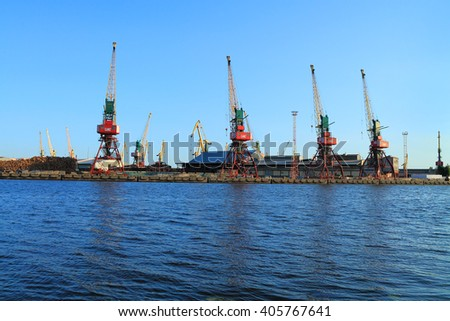 KALININGRAD, RUSSIA - JUNE 4, 2015: Gantry cranes on the shore of the river Pregel in Kaliningrad commercial seaport summer evening