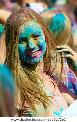 KALININGRAD, RUSSIA - JUNE 12, 2015: Unidentified girl during Holi Festival of Colors, the event is timed to the Day of Russia. - stock photo