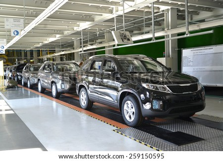 KALININGRAD, RUSSIA - SEPTEMBER 16, 2014: Ready cars stand on the conveyor line of assembly shop. Automobile plant - stock photo