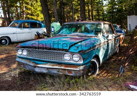 Kalispell - August 2:  Old cars and trucks in the  junk yards August 2, 2015 at Kalispel, MT.