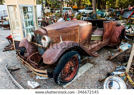 Kalispell, MT - August 2: Old cars and trucks in the junk yards on August 2, 2015 in Kalispell, MT. - stock photo