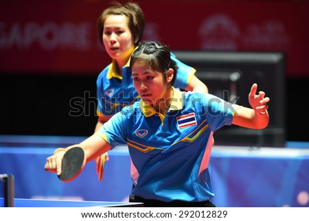 KALLANG,SINGAPORE-JUNE1:Suthasini.S and Nanthana.K of Thailand in action during the 28th SEA Games Singapore 2015 between Thailand and Indonesia at Singapore Indoor Stadium on June1 2015 in SINGAPORE. - stock photo
