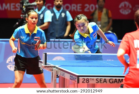 KALLANG,SINGAPORE-JUNE1:Tamolwan.K and Orawan.P of Thailand in action during the 28th SEA Games Singapore 2015 between Thailand and Vietnam at Singapore Indoor Stadium on June1 2015 in SINGAPORE.