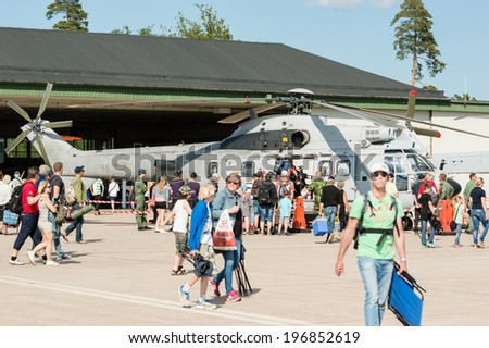 KALLINGE, SWEDEN - JUNE 01, 2014: Swedish Air Force air show 2014 at F 17 Wing. Crowd outside Eurocopter AS332 Super Puma.