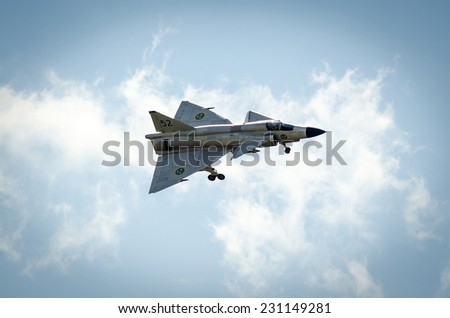 KALLINGE, SWEDEN - JUNE 01, 2014: Swedish Air Force air show 2014 at F 17 Wing in flight with open chassis.