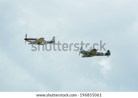 KALLINGE, SWEDEN - JUNE 01, 2014: Swedish Air Force air show 2014 at F 17 Wing. North American P-51 Mustang and Supermarine Spitfire airborne.