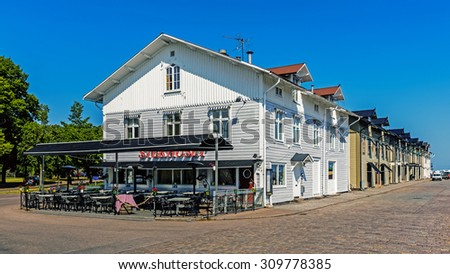 KALMAR, SWEDEN - AUGUST 7, 2015: Wooden houses beside the wharf in Kalmar, city situated by the Baltic Sea with around 36k inhabitants, the seat of Kalmar Municipality and the capital of Kalmar County