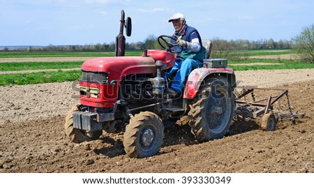 Kalush, Ukraine April 24: Farmer on tractor handles field near the town Kalush, Western Ukraine April 24, 2015