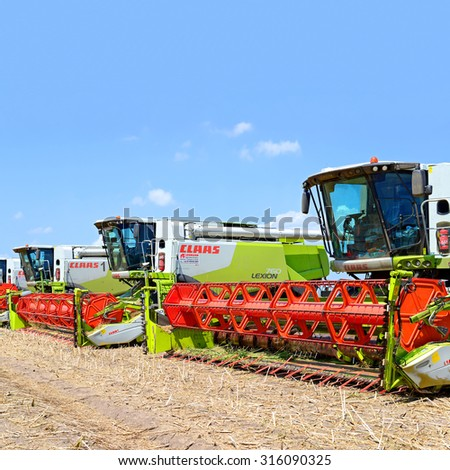 Kalush, Ukraine - July 22: Combines before harvest in the field near the town Kalush, Western Ukraine July 22, 2015 - stock photo