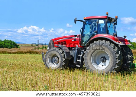 Kalush, Ukraine - July 21: Modern tractor in a field near the town Kalush,Western Ukraine July 21, 2016