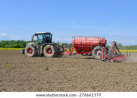 Kalush, Ukraine - May 10: Planting corn trailed planter in the field near the town of Kalush, Western Ukraine May 10, 2015
