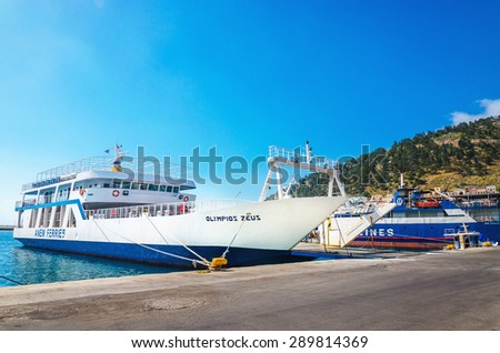 KALYMNOS, GREECE - MAY 01, 2015: Docked Greek Ferry in painted typical blue-white colors waiting in harbour to be loaded with cars