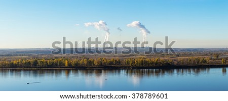 Kama River and the city of Nizhnekamsk with petrochemical production - stock photo