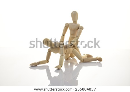 kama sutra wooden dummy intercourse sex  - stock photo
