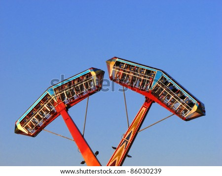 Kamikaze in mid air in a funfair - stock photo