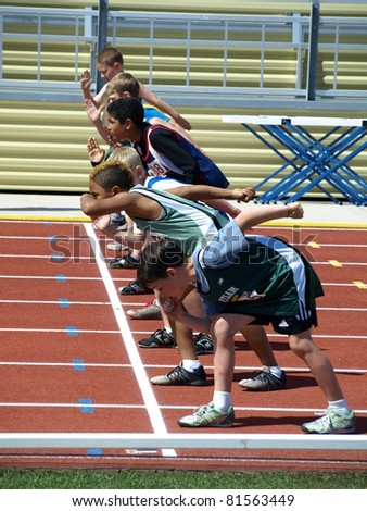 KAMLOOPS, CANADA-JULY 23:unidentified boys on the start of the 100 meters dash on the BC Junior Development  Track and Field Championships July 23, 2011 in Kamloops , Canada - stock photo