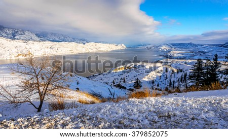 Kamloops Lake in central British Columbia, Canada on a cold and crisp Winter Day under a blue sky - stock photo