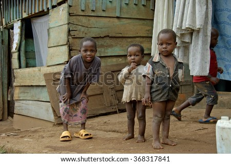 Kampala, Uganda-11 April 2017. Brothers and sister playing in front of their house in Kampala township. - stock photo