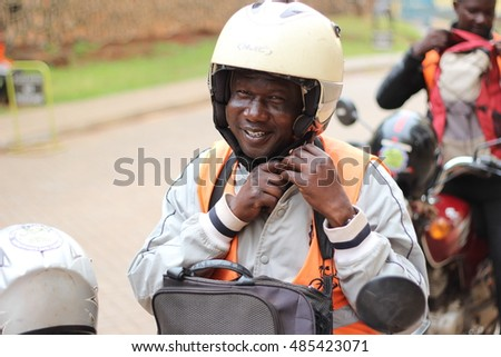 KAMPALA, UGANDA - CIRCA NOVEMBER 2015: A Ugandan biker locally known as a boda boda driver.